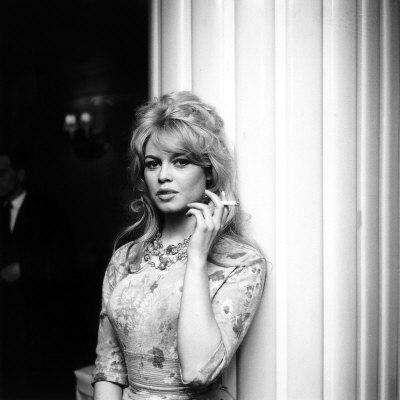 brigitte bardot smoking a cigarette upon arrival in london april 1959 Brigitte Bardot