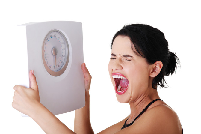 Frustrated woman with scale Debeli i seksi